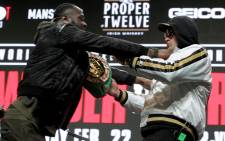 US boxer Deontay Wilder (L) and British boxer Tyson Fury get into an altercation during their press conference 19 February 2020 at the MGM Grand Las Vegas in Las Vegas, Nevada. The boxers will fight for the World Boxing Council (WBC) Heavyweight Championship Title on 22 February 2020 at the MGM Grand Garden Arena in Las Vegas. Picture: AFP