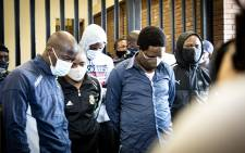 Five suspects - Khulela Themba Sibiya, Bongani Sandiso Ntanzi, Mthobisi Chris Mncube, Mthokoziseni Zifozonke Mapisa and Sifiso Ntuli - appeared at the Boksburg Magistrates Court on 27 October 2020. They are charged with the 2014 murder of Bafana Bafana and Orlando Pirates captain Senzo Meyiwa. The suspects refused to stand in the dock, saying they were innocent and would not answer for a crime they did not commit. Picture: Xanderleigh Dookey/EWN.