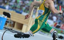 Oscar Pistorius competes in the men's 4x400 metre relay heats at the IAAF World Championships in Daegu on 1 September 2011. Picture: AFP