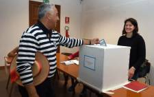 A gondoliere casts his ballot at a polling station during an autonomy referendum in Venice, on 22 October 2017. Picture: AFP