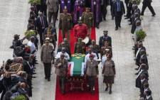 The coffin carrying the body of the late anti-apartheid activist Winnie Madikizela-Mandela leaves Orlando Stadium in Soweto. The late struggle icon will be laid to rest at Fourways Memorial Park next to her great-grandchildren. Picture: Ihsaan Haffejee/EWN.