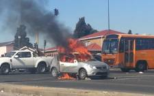 A car was set alight on the West Rand on 21 June. Picture: Craig Schutte/iWitness