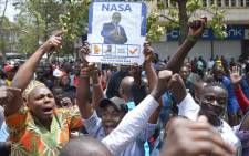 FILE: Supporters of Kenya's opposition National Super Alliance celebrate outside the Supreme Court in Nairobi on 1 September 2017 after Kenya's Supreme Court ordered a new presidential election. Picture: AFP.