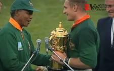 The late Nelson Mandela congratulates RWC winning Bok captain, Francois Pienaar.
