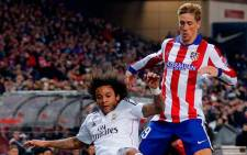 Atletico Madrid's Fernando Torres and Real Madrid's Marcelo fighting for the ball during their first leg in the Kings Cup last 16 tie on 7 January 2015. Picture: Real Madrid official Facebook page.