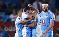 Bulls players celebrate a try. Picture: AFP