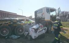 The car was found underneath the truck on the side of the road. Picture: Twitter: @ER24EMS.