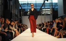 A model presents a creation from the 2013 spring/summer collection of British fashion designer Paul Smith at London Fashion Week in London on September 16, 2012. Picture: AFP.