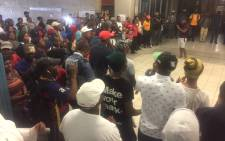 Protesting Wits University medical school students gather inside a hall with their parents, academics and student leaders as they discuss way forward regarding free education. Picture: Kgothatso Mogale/EWN.