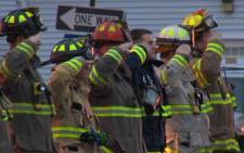 New York firemen during a memorial for their colleauges killed in an ambush. Picture: CNN.
