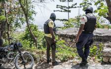 """Police are on the lookout for others suspected assassins of Haitian President Jovenel Moise outside the Embassy of Taiwan in Port-au-Prince, Haiti on July 9, 2021. Joanne Ou, a spokesperson for Taiwan's Ministry of Foreign Affairs, said the embassy was closed """"for safety reasons"""" after the brazen murder of Moise on 7 July 2021. Picture: AFP."""