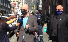 The DA's Michael Cardo (left) speaks to the media after laying a criminal complaint at the Cape Town Central Police Station on 7 September 2021 against the ANC's top six over the ruling party's alleged failure to pay UIF contributions for employees. Picture: @Our_DA/Twitter