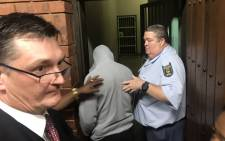 Nicholas Ninow, who is accused of raping a seven-year-old girl, is led away after making an appearance at the Pretoria Magistrates Court on 2 October 2018. Picture: Christa Eybers/EWN