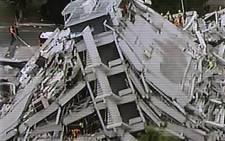 This TV frame from from NZ TV3 via Sky News shows a collapsed building after a 6.3 earthquake hit Christchurch on 22 February 2011. Picture: AFP