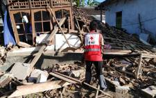 An Indonesia Red Cross official works through the aftermath of an earthquake. Picture: @palangmerah/Twitter