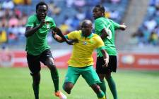 FILE: Tokelo Rantie (C) battles for the ball with Zambia's Kondwani Mtonga (L) and Davies Nkausu (R) during the friendly football match between Zambia and South Africa at Orlando Stadium in Johannesburg on 4 January 2015. Picture: AFP.