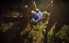 Members of the SANDF detain a suspect during a vehicle recovery operation on the Mozambique/South Africa border. Picture: Thomas Holder/EWN