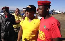 FILE: Businessman Kenny Kunene (in yellow) and members of the EFF arrive in Marikana, ahead of the anniversary of the shooting in which 34 miners were killed. Picture: Christa van der Walt/EWN
