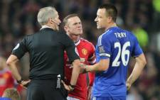 Referee, Martin Atkinson, talks to captains of both team, Manchester United's Wayne Rooney and John Terry in the English Premier League on 28 December 2015. Picture: Manchester United official Facebook page.