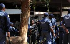 Miners, arrested during a shootout at Lonmin's Marikana mine, arrive under heavy police guard to appear in court in Ga-Rankuwa, north of Pretoria, Monday, 20 August 2012. Picture: Werner Beukes/SAPA