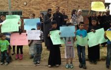 Children standing outside the Lenasia home where sisters were killed. 18 September 2013. Picture: Masego Rahlaga/EWN