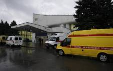 Ambulances are seen outside the airport entrance following the crash of a FlyDubai Boeing 737 aircraft in the city of Rostov-on-Don on 19 March 2016. Picture: AFP.