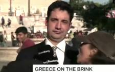 A screen grab from CNN's report on a Greek mic-grabbling heckler. Picture: CNN