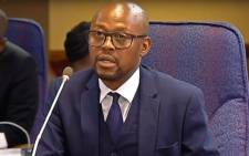 A screengrab of former NPA prosecutor Advocate Simphiwe Mlotshwa giving evidence at the Mokgoro Inquiry on 2 February 2019.