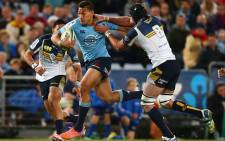 Waratahs star Israel Folau tries to burst through the clutches of the Brumbies defence. Picture: Official Super XV Rugby Facebook Page.