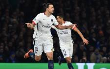 Paris Saint-Germains Swedish forward Zlatan Ibrahimovic celebrates scoring his teams second goal during the UEFA Champions League round of 16 second leg football match between Chelsea and Paris Saint-Germain (PSG) at Stamford Bridge in London on 9 March, 2016. Picture: AFP.