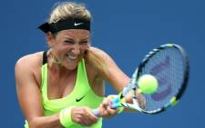 Victoria Azarenka of Belarus returns a shot against Samantha Stosur of Australia during their women's singles quarterfinals match on Day Nine of the 2012 US Open. Picture: AFP.