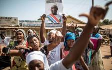 Gambians celebrate opposition candidate Adama Barrow's victory in the country's presidential elections. Picture: AFP