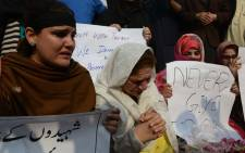 Pakistan civil society activists mourn children and teachers killed in an attack by militants on an army-run school in Peshawar on 18 December, 2014. Picture: AFP.
