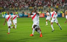 Peru's Christian Ramos (C) celebrates after scoring against New Zealand during their 2018 World Cup qualifying play-off second leg football match, in Lima, Peru, on November 15, 2017. Picture: AFP