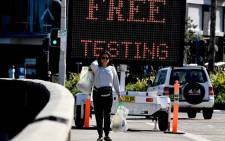An electronic screen advertises free COVID-19 testing being offered at Bondi Beach in Sydney on 22 April 2020.  Picture: AFP