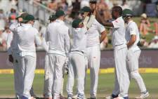 Proteas fast bowler Kagiso Rabada (second from the right) is congratulated by his teammates after taking a wicket. Picture: @OfficialCSA/Twitter