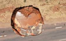 A four-meter-deep sinkhole on Snake Road near the N12 is being investigated. Picture: Jacob Mamabolo/Twitter