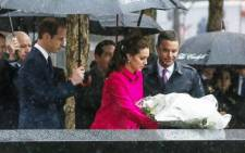 The Duchess Of Cambridge (C) lays a wreath for 9/11 victims next to the Duke of Cambridge (2nd-L ) while the royal couple pause for reflection in the Memorial Plaza at ground zero on 9 December 2014 in New York. Picture: AFP.