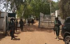 Nigerian soldiers and police officers stand at the entrance of the Federal College of Forestry Mechanisation in Mando, Kaduna state, on March 12, 2021, after a kidnap gang stormed the school shooting indiscriminately before taking at least 30 students around 9:30pm (2030 GMT) on March 11, 2021. Picture: Bosan Yakusak /AFP.