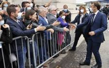 French President Emmanuel Macron greets the crowd on the Champs-Elysees avenue after the annual Bastille Day military parade in Paris on July 14, 2021. Picture: Ludovic Marin / POOL / AFP