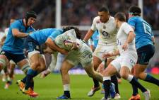 FILE: England's wing Jonny May (C) is tackled during the Six Nations international rugby union match between England and Italy at Twickenham Stadium in south west London on 14 February, 2015. Picture: AFP