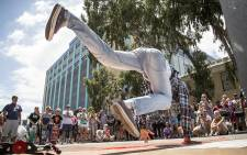B-Boys break dance for an audience outside the Christiaan Barnard Hospital during the Open Streets on Bree Street in Cape Town today. Picture: Thomas Holder/EWN