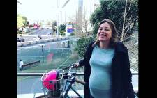 This handout photo taken on 19 August 2018 shows New Zealand's Minister for Women Julie Anne Genter after biking her way to a hospital for the birth of her first child in Auckland. Picture: AFP.