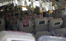 This handout photo provided July 7, 2013 by the National Transportation Safety Board(NTSB), shows an interior view of Asiana Flight 214 during their first site assessment by the NTSB in San Francisco, California.