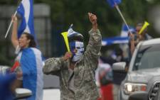 FILE: A demonstrator holds his arm up during the march demanding the resignation of President Daniel Ortega and the end of the state repression on 15 July 2018. Picture: AFP
