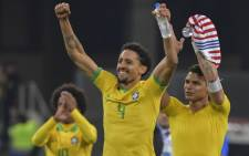 Brazil's Willian (L), Marquinhos (C) and Thiago Silva acknowledge the crowd after defeating Paraguay in a penalty shoot-out during their Copa America quarterfinal match at the Gremio Arena in Porto Alegre, Brazil, on 27 June 2019. Picture: AFP