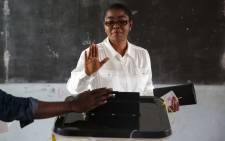 In this file photo taken on 06 October 2018, Rose Christiane Ossouka Raponda, casts her vote at a polling station in Libreville, during the first round of the country's legislative and municipal elections. Picture: AFP