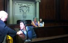 Murder accused Johannes de Jager speaks to his lawyer while Charmaine Mare's mother and friend wait for proceedings to get underway. Picture: Graeme Raubenheimer/EWN.