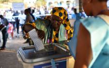A women cast her ballot as part of the general elections on 7 March 2018 at a polling station in Freetown in Sierra Leone. Picture: AFP