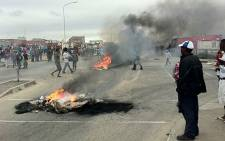 FILE: Protesting residents burn tyres. Picture: Malungelo Booi/EWN